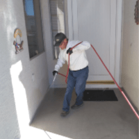 Home Pest Control - Croach - Aurora, CO - Technician spraying for spiders